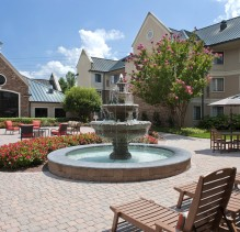 A beautiful fountain in the Staybridge Suites Charlotte Ballantyne coutyard